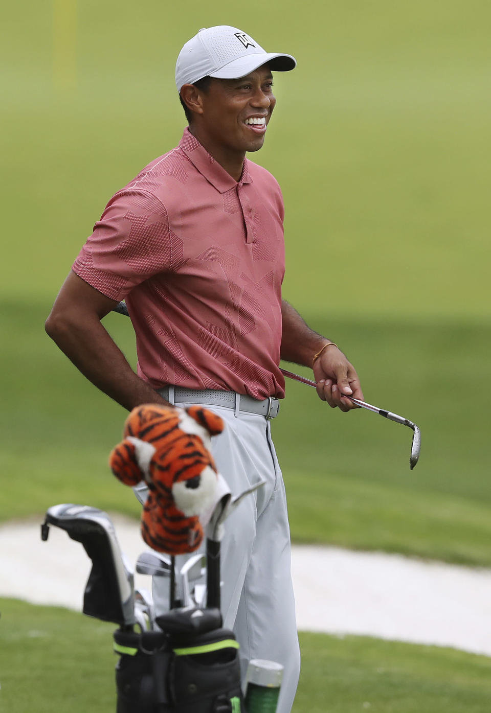Tiger Woods smiles on the practice range at Augusta National Golf Club in Augusta, Ga., Tuesday, Nov. 10, 2020. The Masters golf tournament begins Thursday in Augusta. (Curtis Compton/Atlanta Journal-Constitution via AP)