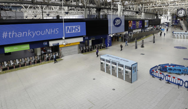 An almost empty Waterloo Station in London at 9am, Wednesday, May 13, 2020, as the country continues in lockdown to help stop the spread of coronavirus. Some of the coronavirus lockdown measures are being relaxed in England on Wednesday, with those workers who are unable to work from home, such as those in construction and manufacturing, encouraged to return to work. (AP Photo/Kirsty Wigglesworth)