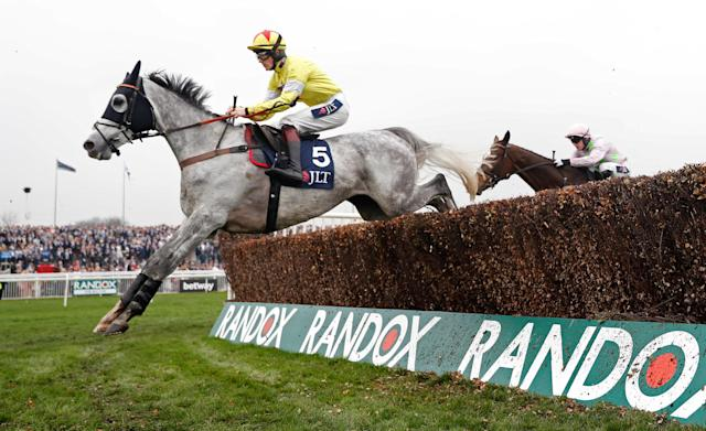 Horse Racing - Grand National Festival - Aintree Racecourse, Liverpool, Britain - April 13, 2018 Politologue ridden by Sam Twiston-Davies in action before winning the 15:25 JLT Melling Chase Action Images via Reuters/Matthew Childs