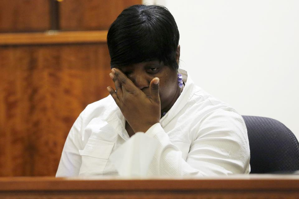 Ursula Ward, mother of Odin Lloyd, wipes her eyes after looking at a photograph from the medical examiner's office of her dead son during the murder trial of former New England Patriots tight end Aaron Hernandez at Bristol County Superior Court in Fall River, Massachusetts February 4, 2015. Hernandez is accused of the murder of semi-professional football player Lloyd in 2013. REUTERS/Brian Snyder (UNITED STATES - Tags: CRIME LAW SPORT FOOTBALL)