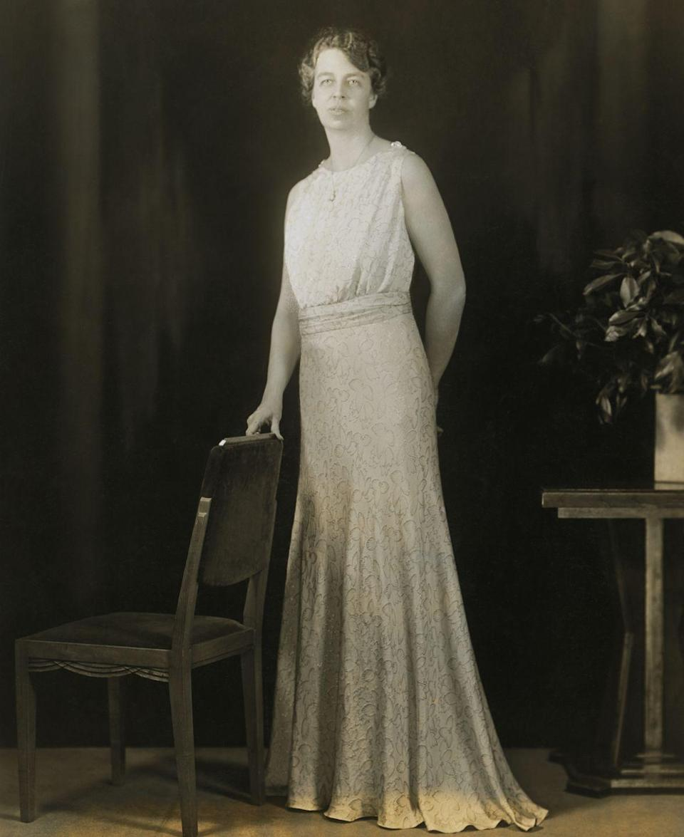 <p>President Roosevelt celebrated his inauguration with a ball in 1933 and his wife, Eleanor Roosevelt, didn't disappoint with her inaugural gown. Here, the First Lady poses in her silver and blue lamé stitched dress. </p>