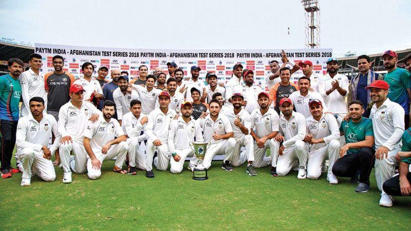 The Afghanistan team with the Indian team at the end of the Test Match