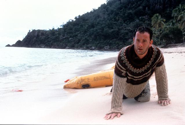 Tom Hanks washed up on the beach of an island in a scene from the film 'Cast Away', 2000. (Photo by 20th Century-Fox/Getty Images)