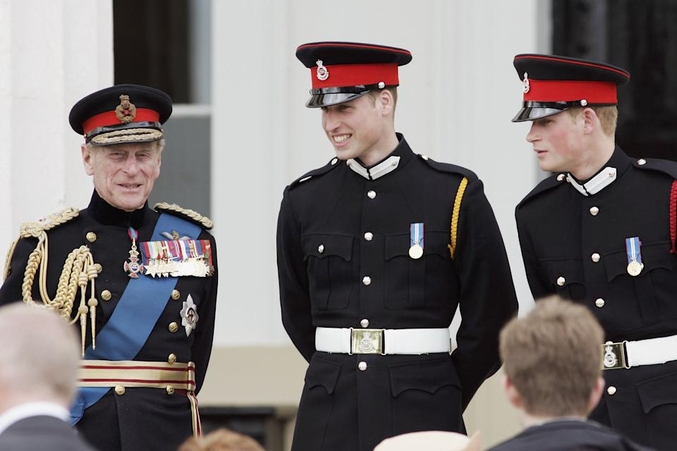 Prince Philip with Prince William and Prince Harry in military outfits