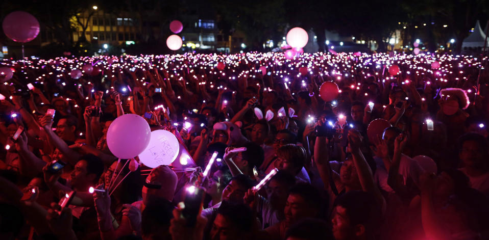 People with LED lights take part in forming a giant pink dot at the Speakers' Corner in Hong Lim Park in Singapore June 30, 2012. About 15,000 people took part in the Pink Dot Sg event to promote acceptance of the Lesbian, Gay, Bisexual, Transgender (LGBT) community in Singapore, the organizer said.  REUTERS/Tim Chong (SINGAPORE - Tags: CIVIL UNREST SOCIETY)
