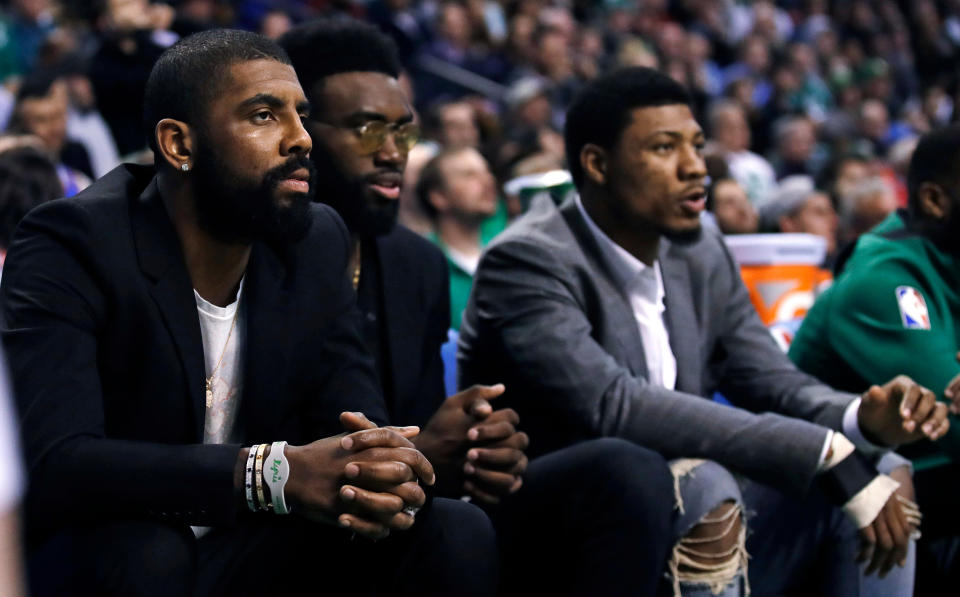 Danny Ainge explained that Kyrie Irving had a good reason for missing Sunday's Game 7 after his absence drew criticism. (AP)