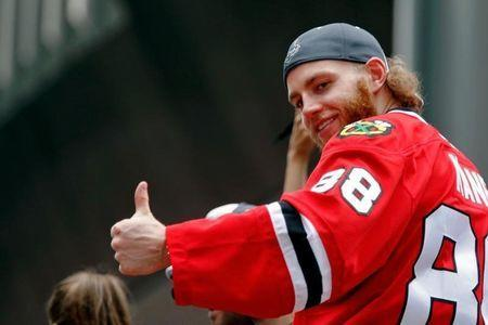 Jun 18, 2015; Chicago, IL, USA; Chicago Blackhawks right wing Patrick Kane (88) gives a thumbs up to the crowd during the 2015 Stanley Cup championship parade and rally at Soldier Field. Mandatory Credit: Jon Durr-USA TODAY Sports