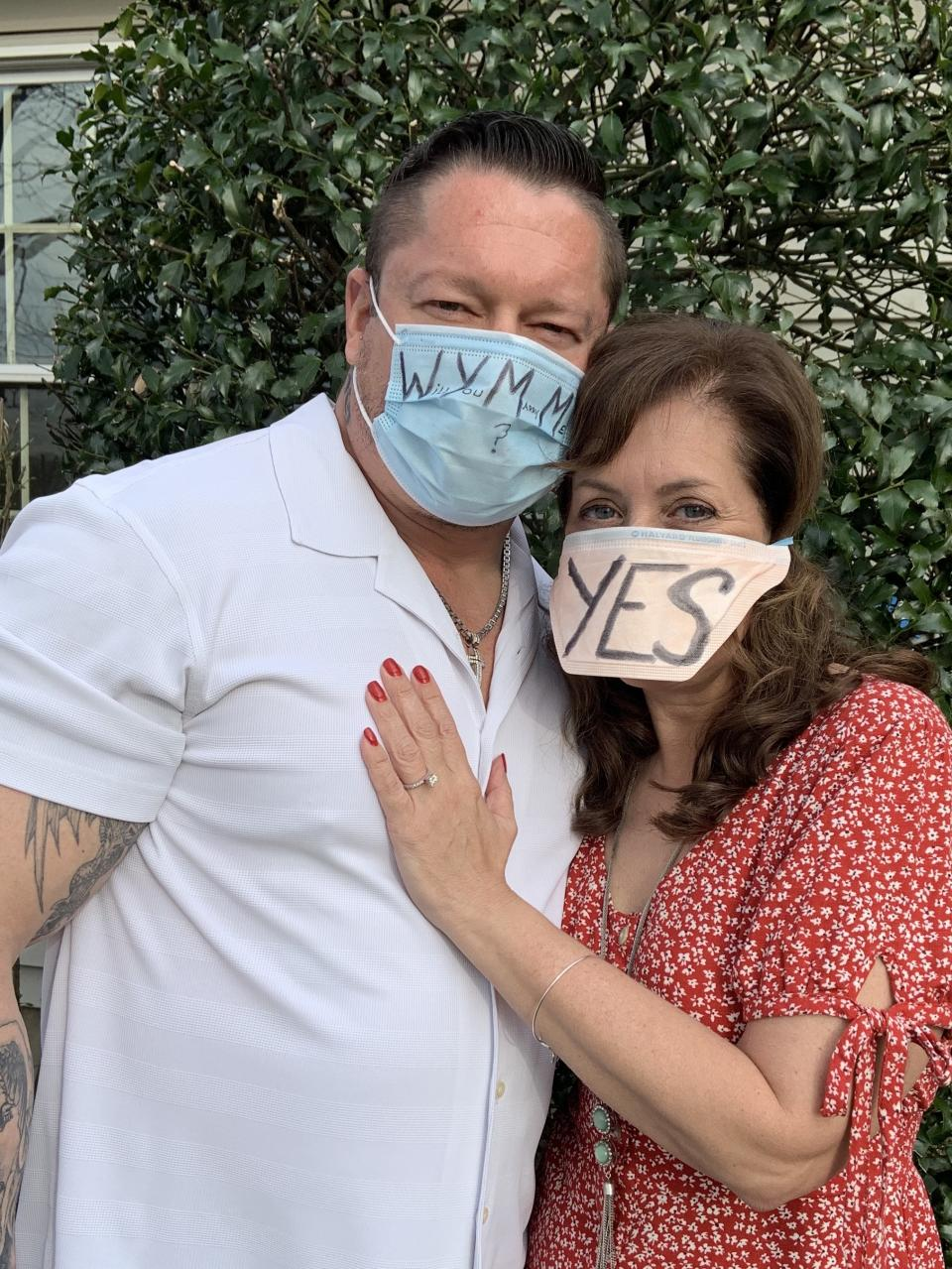 """Police Lieutenant Danny Sienkiewicz proposed to his girlfriend Beth Salamon on April 11th by writing """"Will You Marry Me?"""" on his N95 mask as he served her breakfast in bed. (Photo: Beth Salamon)"""