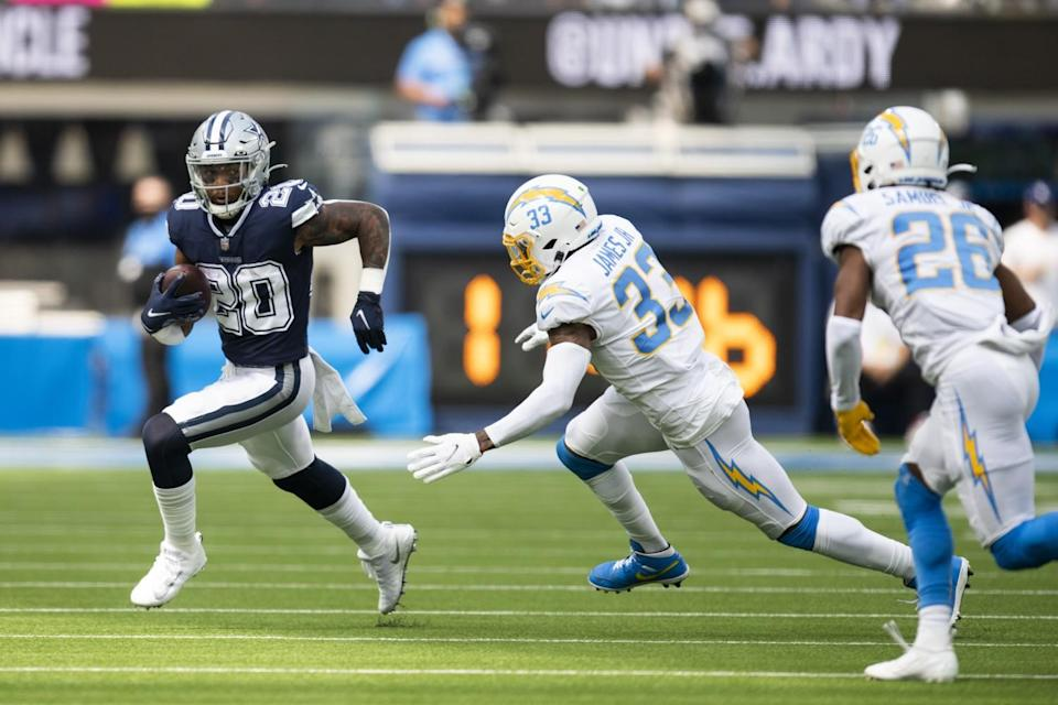 Dallas Cowboys running back Tony Pollard sprints past Chargers free safety Derwin James.