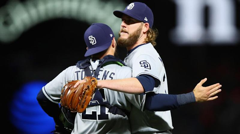 Padres trade pitching trio to Royals