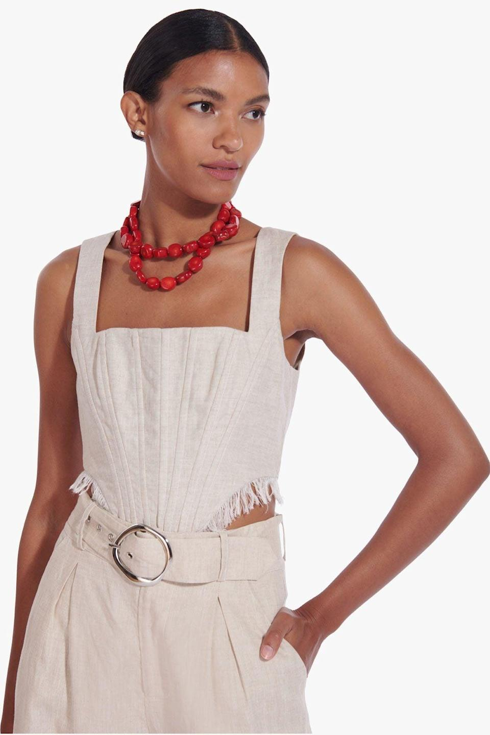 <p>The material of this <span>Staud Triton Top</span> ($235) is unique. We love it for summer nights with linen pants.</p>