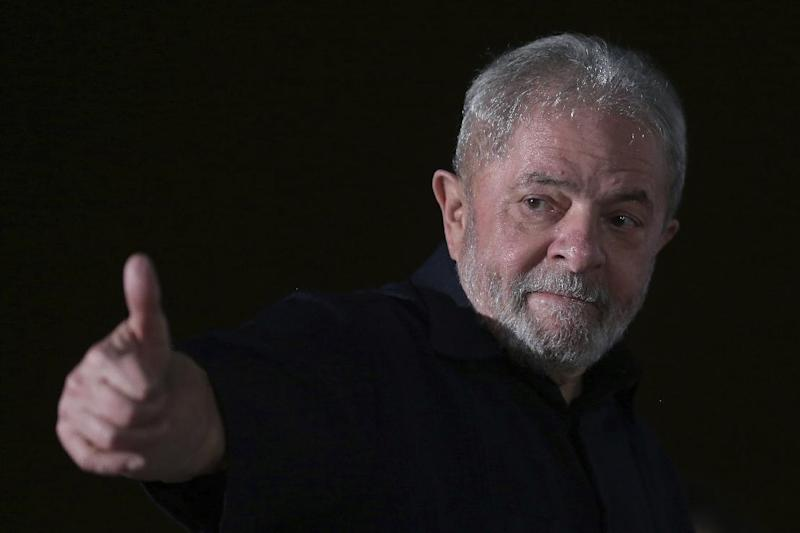 """Brazil's former President Luiz Inacio Lula da Silva gives a thumbs up as he arrives for the opening of the Rural Workers National Congress in Brasilia, Brazil, Monday, March 13, 2017. Lula is expected to testify before a federal judge on Tuesday in the """"The Car Wash"""" bribery scandal. (AP Photo/Eraldo Peres)"""
