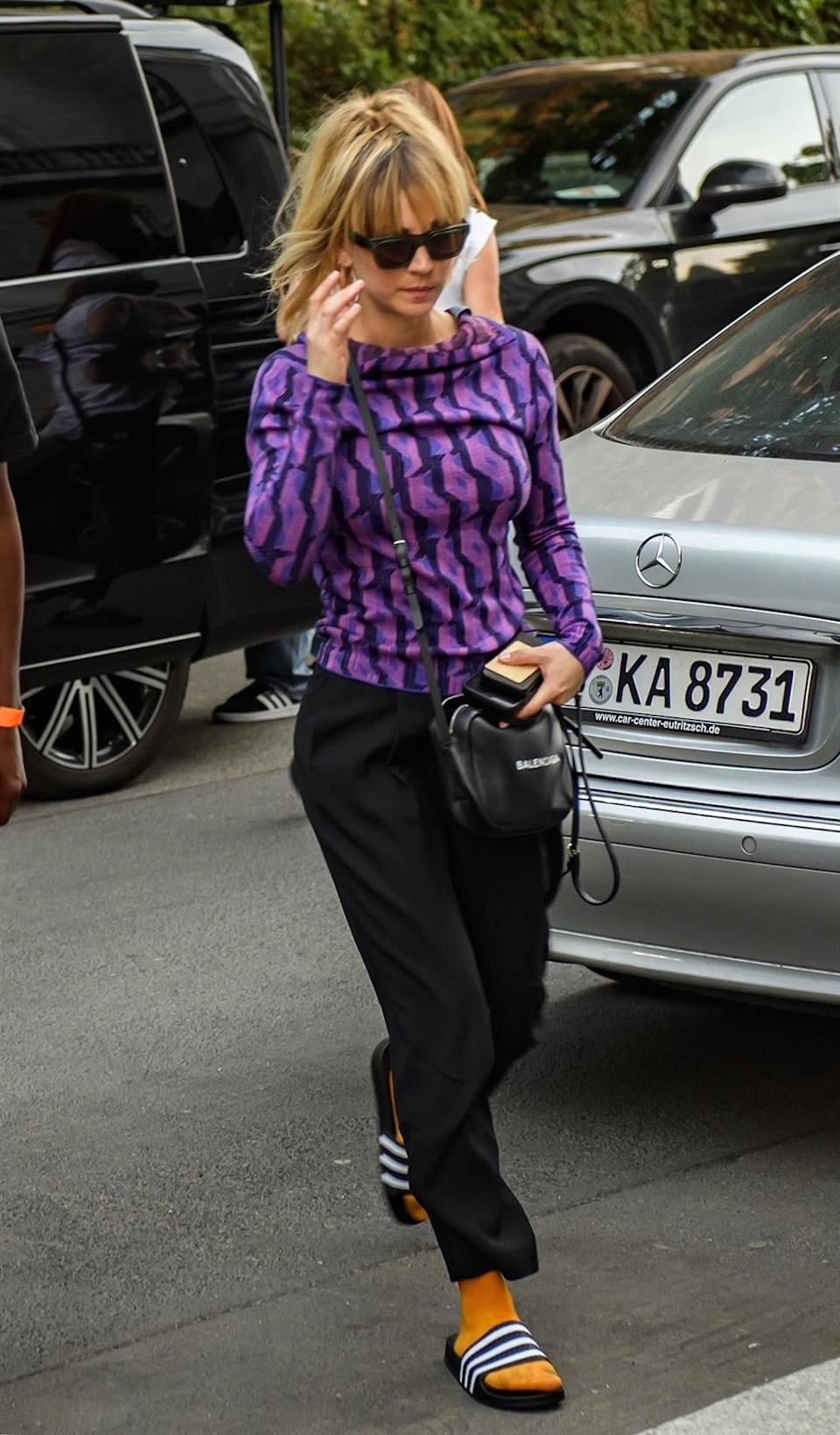 Berlin, GERMANY  - *EXCLUSIVE*  - Actress Kaley Cuoco looks trendy in a purple patterned top as she is pictured leaving her Hotel in Berlin.  The former The Big Bang Theory actress is currently in the capital of Germany to film The Flight Attendant. In addition, the actress recently announced the separation of her and her husband, Karl Cook, after three years of marriage on Friday.  Pictured: Kaley Cuoco  BACKGRID USA 8 SEPTEMBER 2021   BYLINE MUST READ: HIDEF / BACKGRID  USA: +1 310 798 9111 / usasales@backgrid.com  UK: +44 208 344 2007 / uksales@backgrid.com  *UK Clients - Pictures Containing Children Please Pixelate Face Prior To Publication*