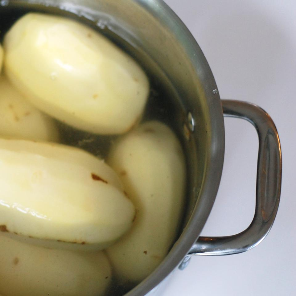 <p>Unlike pasta, you don't want to let the water come to a boil before adding the potatoes. To properly cook the potatoes, add them to a pot and then cover with cold water, enough to cover about an inch above the potatoes.</p>