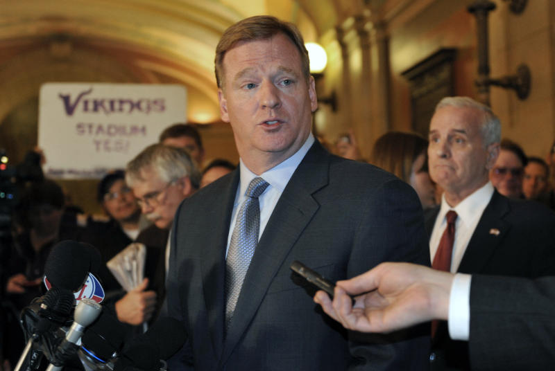 NFL commisioner Roger Goodell answers a question during a media briefing at the State Capitol Friday, April 20, 2012, in St. Paul, Minn., after Goodell met with the governor and state lawmakers in an effort to get a bill passed for a new Minnesota Vikings NFL football stadium. At right is Gov. Mark Dayton. (AP Photo/Jim Mone)