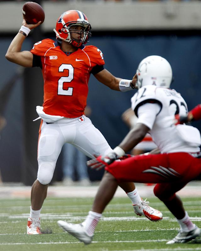 Illinois quarterback Nathan Scheelhaase (2) throws past Cincinnati safety Zach Edwards (22) during the first half of their NCAA college football game on Saturday, Sept. 7, 2013, in Champaign, Ill. (AP Photo/Andrew A. Nelles)