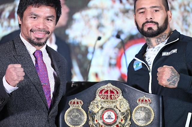 Manny Pacquiao (L) and Argentina's Lucas Matthysse will fight in Kuala Lumpur on Sunday. (AFP Photo/Mohd RASFAN)