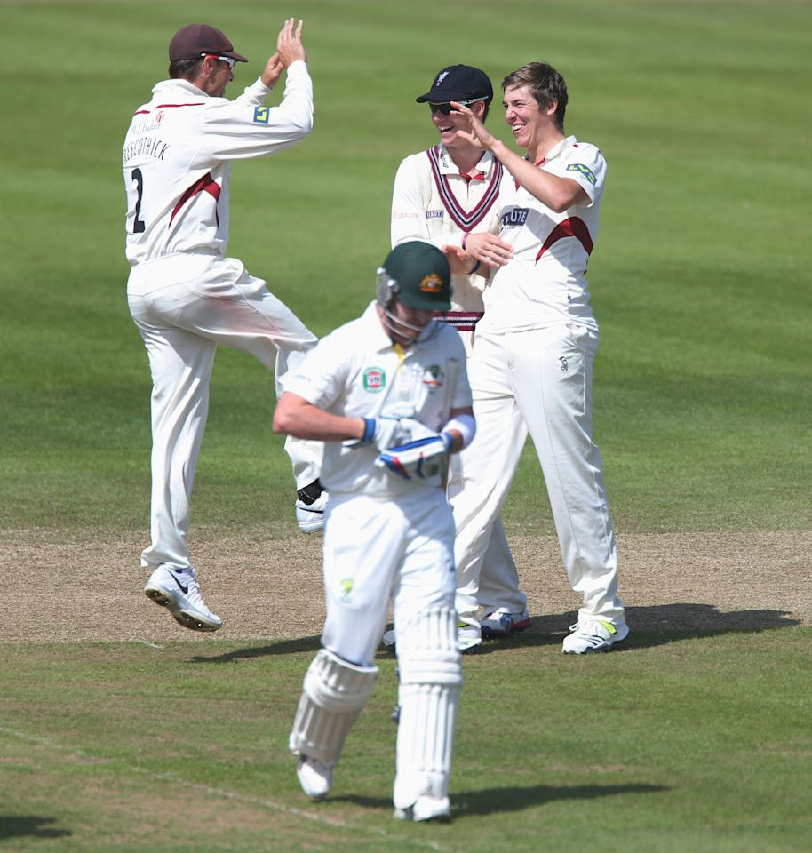 Somerset bowler James Overton (right) celebrates traping Australia batsman Brad Haddin LBW first ball during the International Tour match at the County Ground, Taunton.