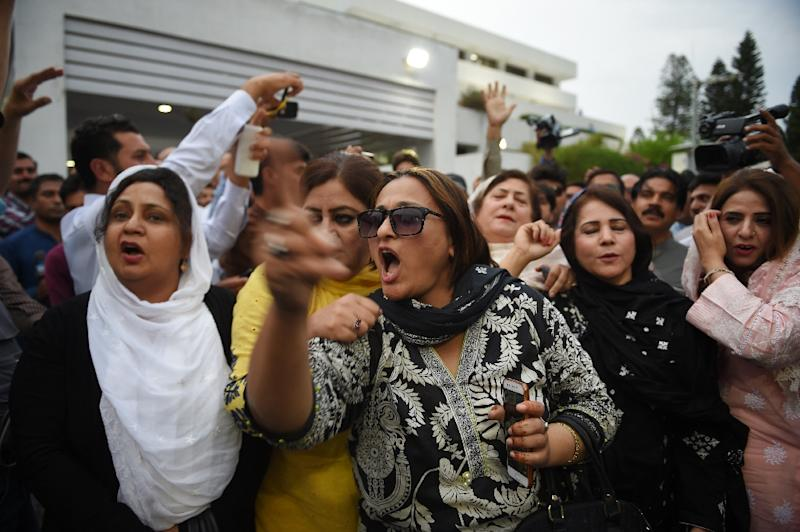 Opposition activists from the Pakistan Muslim League-Nawaz (PML-N) party shout slogans after exiting the National Assembly in Islamabad following the rowdy budget session (AFP Photo/FAROOQ NAEEM)