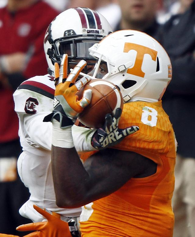 Tennessee wide receiver Marquez North (8) makes a one-handed catch as he's defended by South Carolina cornerback Ahmad Christian (4) late the fourth quarter of an NCAA college football game Saturday, Oct. 19, 2013, in Knoxville, Tenn. Tennessee won 23-21. (AP Photo/Wade Payne)