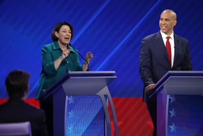 Democratic presidential candidate Sen. Amy Klobuchar speaks as Sen. Cory Booker looks on during the Democratic Presidential Debate at Texas Southern University's Health and PE Center on September 12, 2019 in Houston, Texas. | Win McNamee—Getty Images