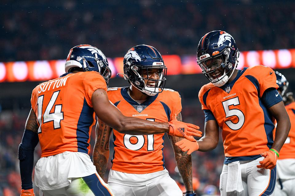 DENVER, COLORADO - AUGUST 28:  Courtland Sutton #14 of the Denver Broncos celebrates with Teddy Bridgewater #5 and Tim Patrick #81 after a second quarter touchdown against the Los Angeles Rams at Empower Field at Mile High on August 28, 2021 in Denver, Colorado. (Photo by Dustin Bradford/Getty Images)