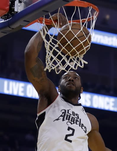 Los Angeles Clippers' Kawhi Leonard scores against the Golden State Warriors in the first half of an NBA basketball game Tuesday, March 10, 2020, in San Francisco. (AP Photo/Ben Margot)