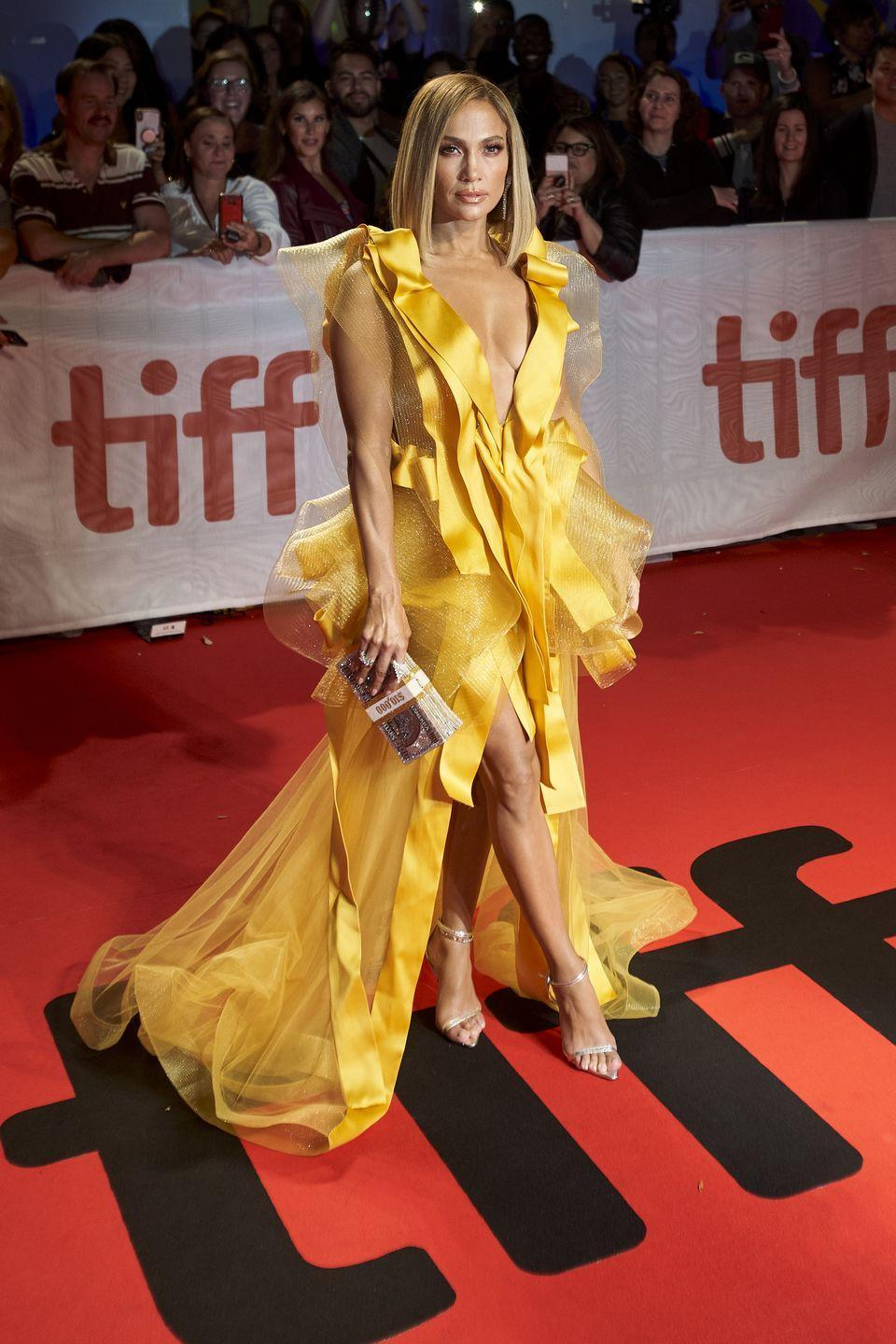 <p>For the Hustlers premiere at TIFF, Lopez - who also serves as an executive producer for the film - wore a yellow ruffle and net gown by Maison Yeya.</p>