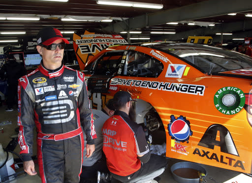 Jeff Gordon leaves the garage area after practice practice for Sunday's NASCAR Sprint Cup Series Sylvania 300 at New Hampshire Motor Speedway, Friday, Sept. 19, 2014, in Loudon, N.H. (AP Photo/Jim Cole)
