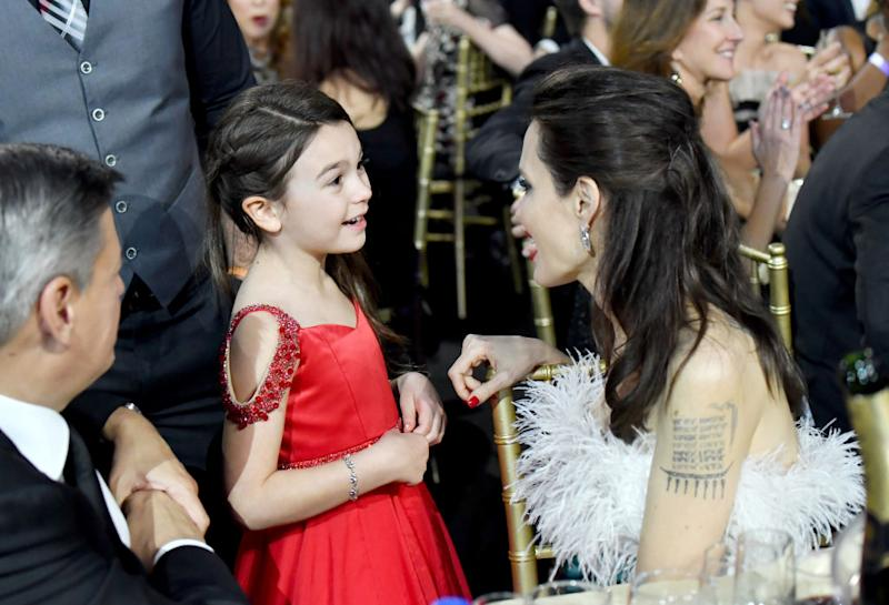 Actors Brooklynn Prince (L) and Angelina Jolie attend The 23rd Annual Critics' Choice Awards at Barker Hangar on January 11, 2018 in Santa Monica, California