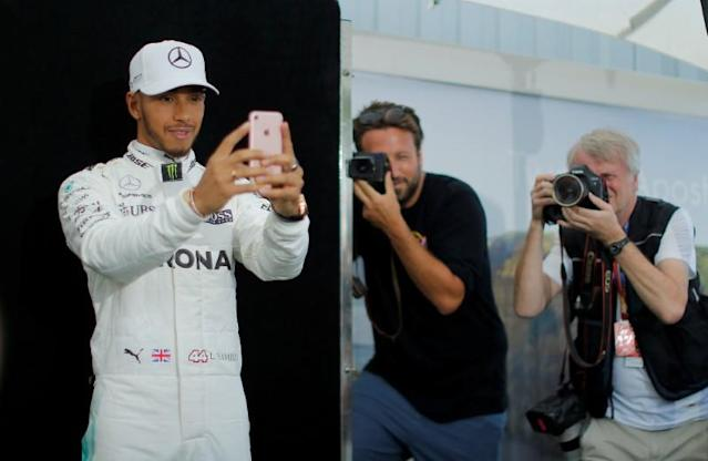 FILE PHOTO: Mercedes driver Lewis Hamilton takes a selfie during the driver portrait session at the first race of the year