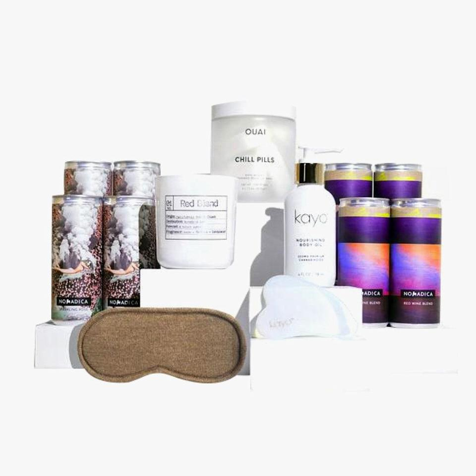 """Canned wine company Nomadica put together a care package of all the goods needed to relax: Parachute merino eye mask, Oaui Chill Pills Bath Bombs, and, of course, their wine. $100, Nomadica. <a href=""""https://www.explorenomadica.com/collections/all-wines/products/kick-pack-kit"""" rel=""""nofollow noopener"""" target=""""_blank"""" data-ylk=""""slk:Get it now!"""" class=""""link rapid-noclick-resp"""">Get it now!</a>"""