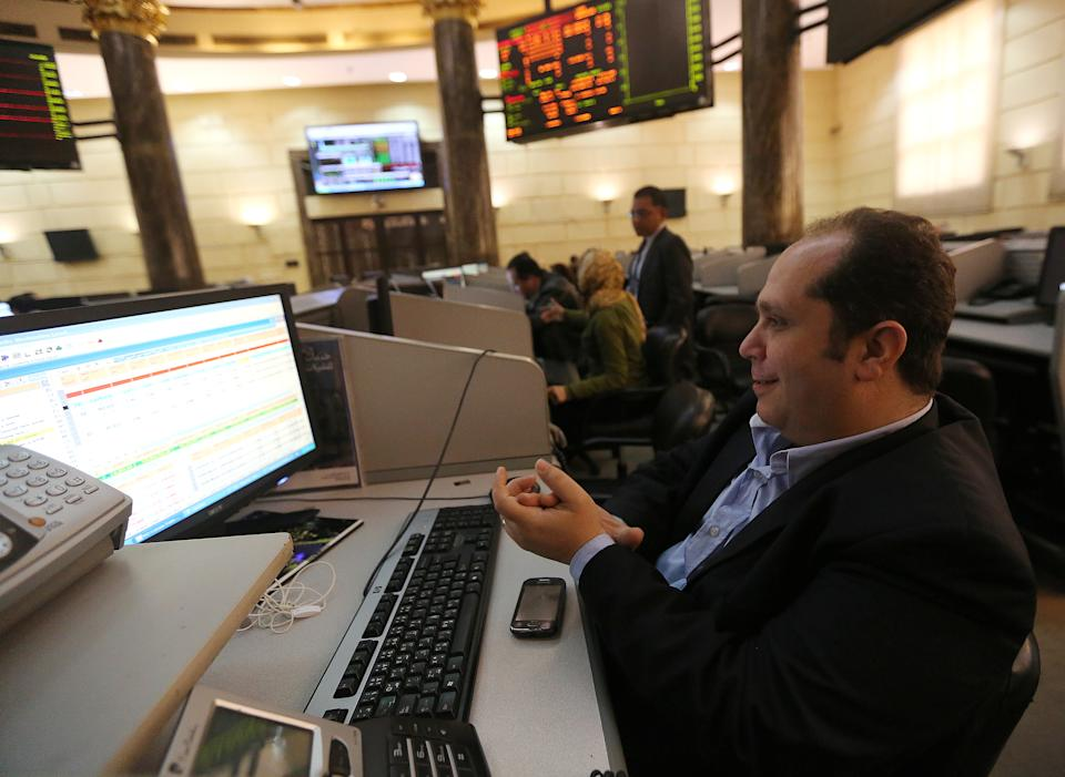 A trader works at the Egyptian stock exchange in Cairo, Egypt, March 8, 2016. Stock markets in the Gulf may firm on Tuesday as investors could be encouraged to enter longer-term positions with further evidence that oil prices may have bottomed. Egypt may be supported by positive earnings from Telecom Egypt. REUTERS/Mohamed Abd El Ghany