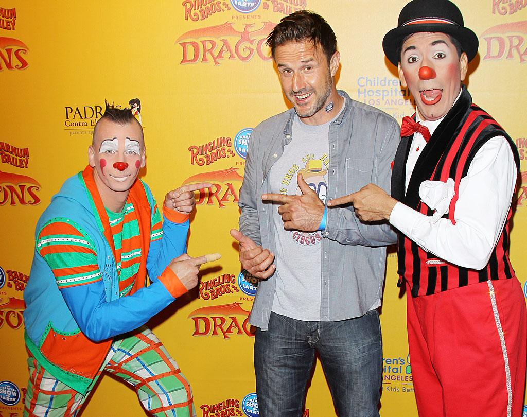"David Arquette, who has been known to don clown-like ensembles on occasion, joked around with some of the pro performers while attending the Ringling Bros. and Barnum & Bailey Circus' L.A. premiere of ""Dragons"" at the Staples Center on Thursday night. (7/12/2012)"