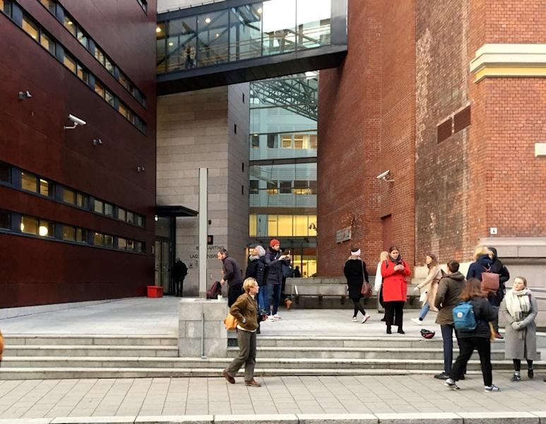 People gather next to the Borgarting Court of Appeals in Oslo