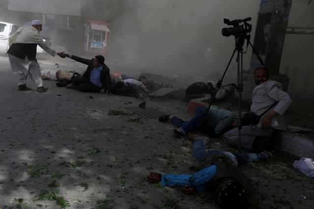 <p>Afghan journalists are seen after a second blast in Kabul, Afghanistan April 30, 2018. (Photo: Omar Sobhani/Reuters) </p>