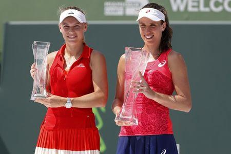 Apr 1, 2017; Key Biscayne, FL, USA; Caroline Wozniacki of Denmark (L) and Johanna Konta of Great Britain (R) hold the finalist trophy and Butch Buchholz Trophy (respectively) after their match in the women's singles championship of the 2017 Miami Open at Crandon Park Tennis Center. Konta won 6-4, 6-3. Mandatory Credit: Geoff Burke-USA TODAY Sports