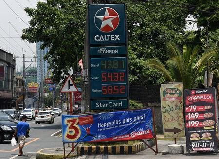 The prices of fuel are seen in a gas station in Kamuning in Quezon City, metro Manila, May 21, 2018. REUTERS/Dondi Tawatao
