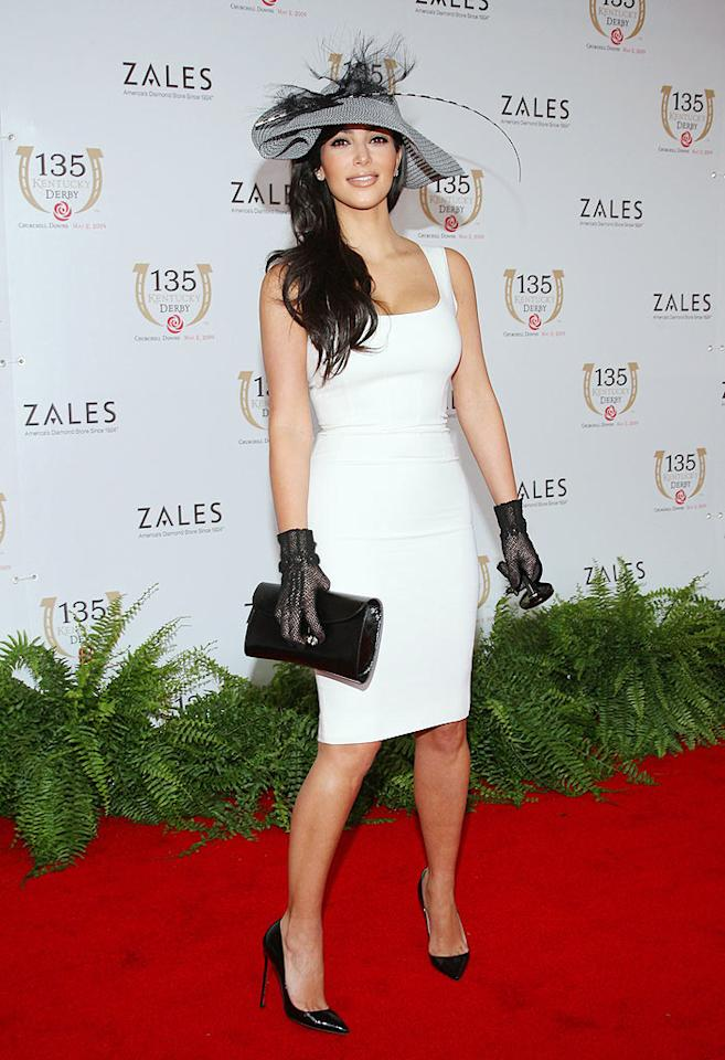 """Kim Kardashian kicked it up a notch at the 135th Kentucky Derby in a gorgeous gray hat, sublime white sheath dress, black gloves, and matching pumps. Jason Kempin/<a href=""""http://www.wireimage.com"""" target=""""new"""">WireImage.com</a> - May 2, 2009"""