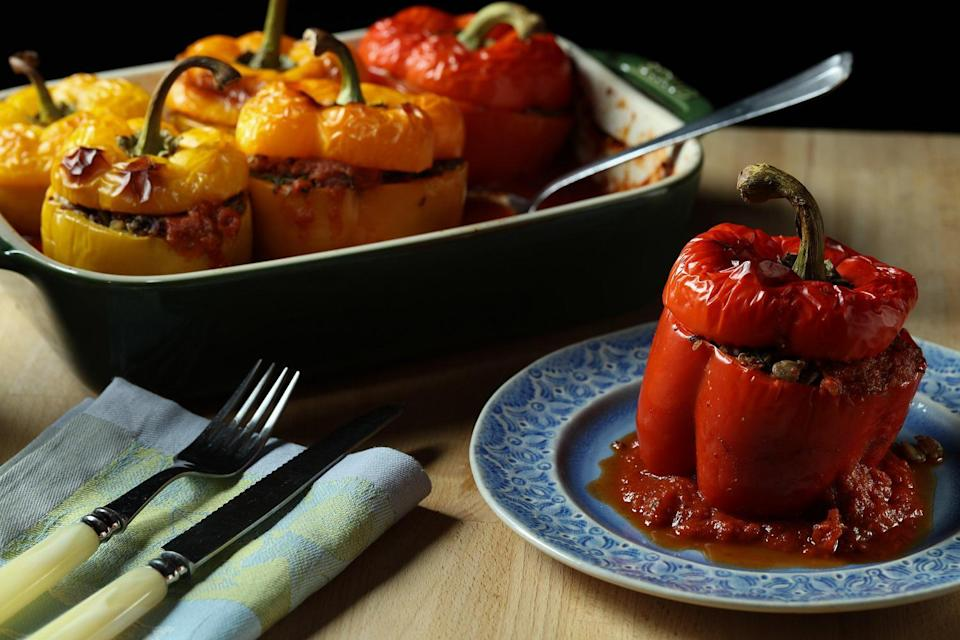 """<p>Stuffed peppers are a dinner staple but instead of using ground beef, this recipe has a savory filling made of lentils, quinoa and rice. Make extra and eat them throughout the week to make <a href=""""https://www.thedailymeal.com/healthy-eating/make-your-meals-easier-guide-meal-prepping-slideshow?referrer=yahoo&category=beauty_food&include_utm=1&utm_medium=referral&utm_source=yahoo&utm_campaign=feed"""" rel=""""nofollow noopener"""" target=""""_blank"""" data-ylk=""""slk:meal prepping a breeze"""" class=""""link rapid-noclick-resp"""">meal prepping a breeze</a>.</p> <p><a href=""""https://www.thedailymeal.com/recipes/quinoa-lentil-stuffed-peppers?referrer=yahoo&category=beauty_food&include_utm=1&utm_medium=referral&utm_source=yahoo&utm_campaign=feed"""" rel=""""nofollow noopener"""" target=""""_blank"""" data-ylk=""""slk:For the Quinoa and Lentil Stuffed Peppers recipe, click here."""" class=""""link rapid-noclick-resp"""">For the Quinoa and Lentil Stuffed Peppers recipe, click here.</a></p>"""