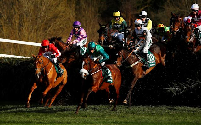 Horse Racing - Grand National Festival - Aintree Racecourse, Liverpool, Britain - April 14, 2018 Double Ross ridden by Thomas Bellamy (L) and Ucello Conti ridden by Daryl Jacob in action during the 17:15 Randox Health Grand National Handicap Chase Action Images via Reuters/Jason Cairnduff