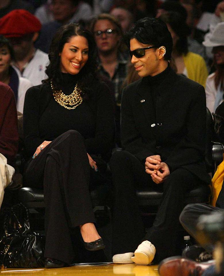 "Prince also had courtside seats, but at times seemed more enamored with his female companion than the game. Kevin Reece/London Ent/<a href=""http://www.splashnewsonline.com"" target=""new"">Splash News</a> - December 25, 2008"