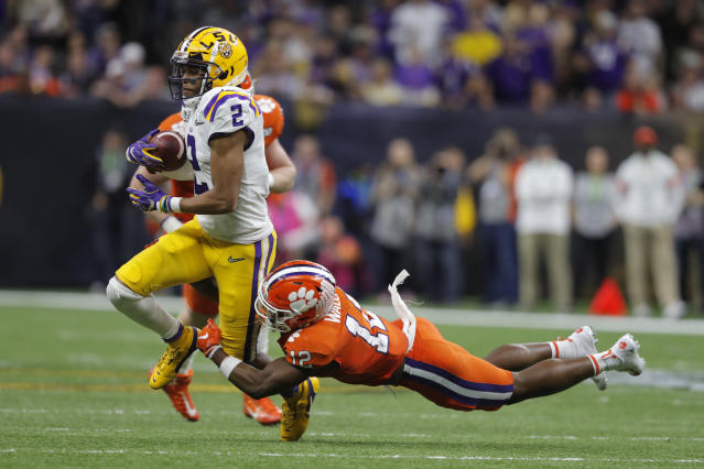 LSU wide receiver Justin Jefferson is tackled by Clemson safety K'Von Wallace during the second half of a NCAA College Football Playoff national championship game Monday, Jan. 13, 2020, in New Orleans. (AP Photo/Gerald Herbert)
