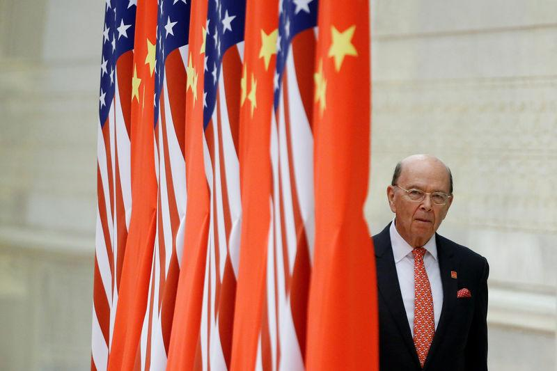 FILE PHOTO: U.S. Commerce Secretary Wilbur Ross arrives at a state dinner at the Great Hall of the People in Beijing