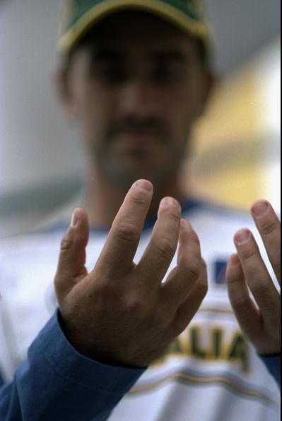 21 Nov 1999:  Justin Langer of Australia displays the bruises left on his hand by a ball from Shoaib Akhtar of Pakistan during the second Test match at the Bellerive Oval in Hobart, Australia.  Australia won the match by four wickets. \ Mandatory Credit:Jack Atley /Allsport