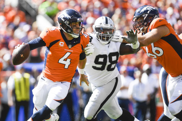 <p>Case Keenum (4) of the Denver Broncos is flushed from the pocket by Frostee Rucker (98) of the Oakland Raiders as Jared Veldheer (66) blocks during the first quarter on Sunday, September 16, 2017. The Denver Broncos hosted the Oakland Raiders. (Photo by AAron Ontiveroz/The Denver Post via Getty Images) </p>