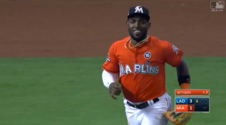 You're allowed to smile after you take away a home run like Marcell Ozuna. (Screenshot via MLB.com)