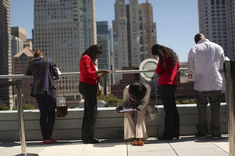 FILE PHOTO: Job seekers apply for the 300 available positions at a new Target retail store in San Francisco