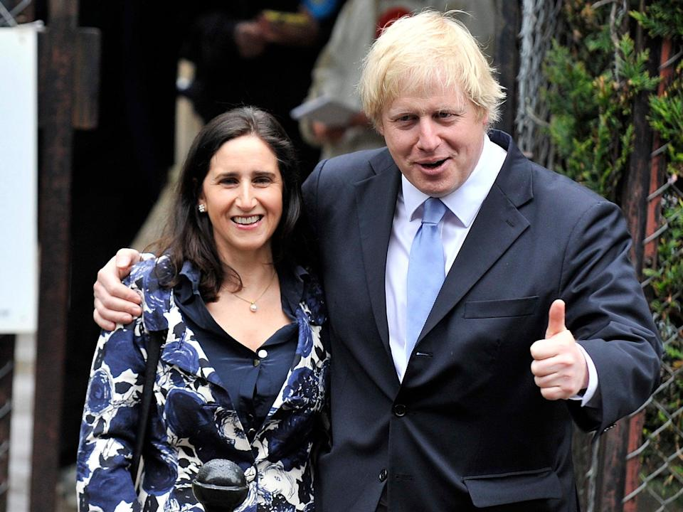 <p>The then mayor of London with Ms Wheeler in May 2012</p> (EPA-EFE)