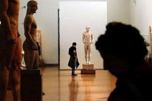 "A visitor looks at antiquities at the National Archeological Museum in Athens on March 18, 2012. Faced with massive public debt, Greece is finding that its fabled antiquity heritage is proving a growing burden. ""Greece's historic remains have become our curse,"" whispers an archaeologist worried about budgets that are badly stretched to nonexistent"